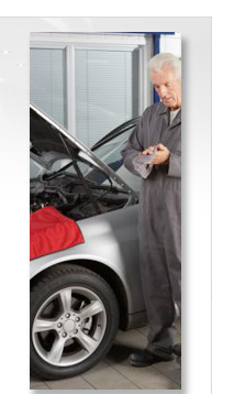 mechanic wiping hands after inspecting an engine